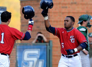 Samford's Phillip Ervin, right, celebrates with a teammate after hitting a home run against UAB (Mark Almond/malmond@al.com)