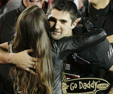 Arkansas State quarterback Ryan Aplin gets a hug from NASCAR racer and GoDaddy.com girl Danica Patrick after leading the Red Wolves to a 17-13 win over Kent State in GoDaddy.com Bowl on Jan. 6, 2012, at Ladd-Peebles Stadium in Mobile, Ala. (Mike Kittrell/mkittrell@al.com)