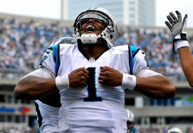 Carolina Panthers quarterback Cam Newton (1) reacts after running for a touchdown against the New Orleans Saints during the fourth quarter of the Panthers' 36-27 victory in Charlotte, N.C., on Sunday, Sept. 16, 2012. (AP Photo/Rainier Ehrhardt)