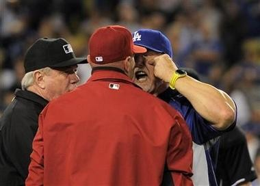 Los Angeles Dodgers batting coach Mark McGwire, right, yells at Arizona Diamondbacks manager Kirk Gibson after Los Angeles Dodgers' Zack Greinke was hit by a pitch during the seventh inning of their game Tuesday night in Los Angeles. (AP Photo/Mark J. Terrill)