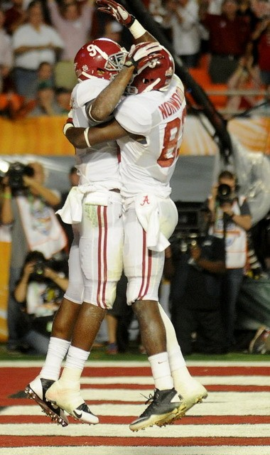 After one of his two touchdown catches in a 42-14 victory over Notre Dame in the BCS Championship Game, Alabama wide receiver Amari Cooper, left, celebrates with Kevin Norwood. (Julie Bennett/jbennett@al.com)