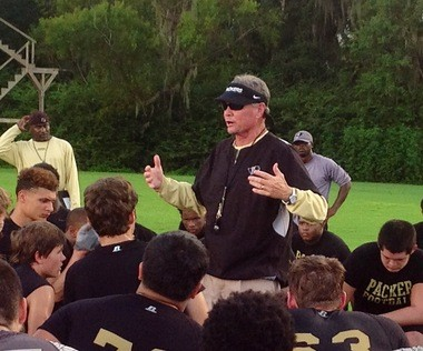 Propst addresses his team in Moultrie, Georgia on August 20, 2013 at an afternoon football practice. Panama City Beach is two hours away in one direction. His team practices on a field draped by trees dotted with Spanish moss and with dragonflies buzzing overhead.