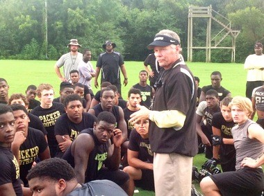Rush Propst listens to the Colquitt County trainer dispense some advice to his players at the end of a football practice on August 20, 2013 in Moultrie, Georgia. The Packers have been practicing two times per day leading up to the start of the 2013 season.
