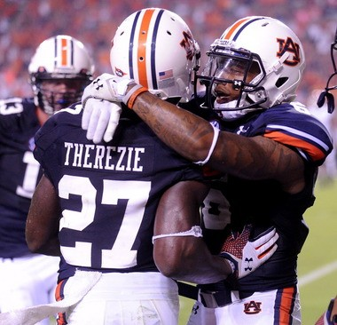 Robenson Therezie (27) gets a hug from Auburn teammate Jonathon Mincy after he made an interception in the end zone during the Tigers' victory over Washington State on Saturday, Aug. 31, 2013, at Jordan-Hare Stadium in Auburn, Ala. (Julie Bennett/jbennett@al.com)