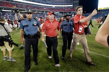 Western Kentucky football coach Bobby Petrino leaves the field after the Hilltoppers defeated Kentucky on Saturday, Aug. 31, 2013, in Nashville, Tenn. (AP Photo)