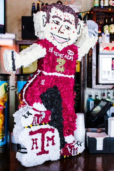 """Shelly Pricer of It's My Party in Cullman created """"Johnny Pinata,"""" who has a Sharpie in one hand and fake money in the other. (Harry Long photo)"""