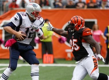 Cincinnati Bengals defensive end Wallace Gilberry pressures New England Patriots quarterback Tom Brady during an NFL game on Sunday, Oct. 6, 2013, in Cincinnati. (AP Photo)