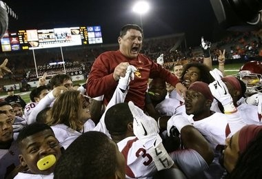 USC interim coach Ed Orgeron got a ride from his players after the Trojans upset Oregon State on the road. (The Associated Press)
