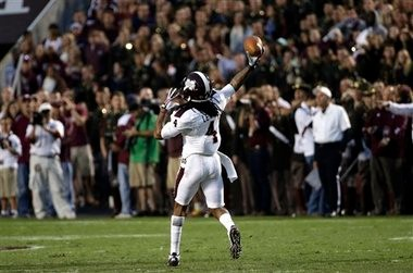 Mississippi State wide receiver Jameon Lewis throws a touchdown pass against Texas A&M during an SEC game on Saturday, Nov. 9, 2013, in College Station, Texas. (AP Photo)