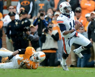 Auburn quarterback Nick Marshall runs away from Tennessee linebacker Brent Brewer during an SEC game on Saturday, Nov. 9, 2013, at Neyland Stadium in Knoxville, Tenn. (Julie Bennett/jbennett@al.com)
