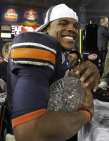 Cam Newton guided Auburn to the 2011 BCS championship over Oregon as a junior-college transfer.
