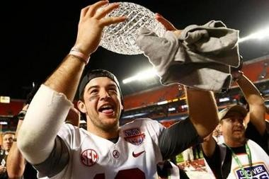 AJ McCarron holds the crystal ball after Alabama's 2013 BCS championship win over Notre Dame.