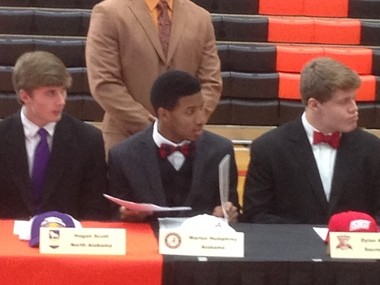 Humphrey sat next to four other members of the 2014 back-to-back Class 6A state champion Hoover football team on Wednesday at a ceremony at Hoover High.