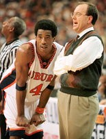 Ellis, pictured with former Tigers star Chris Porter, coached at Auburn for 10 seasons, sending the Tigers to the NCAA Tournament three times. (File)