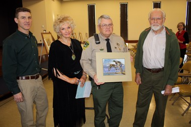 Wildlife and Freshwater Fisheries' Keith Gauldin, and Alabama duck stamp judges Sue Taylor White, Steve Pepper and and Dr. Bill Summerour with Eddie LeRoy's winning painting. (Courtesy ADCNR)