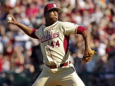 In this March 2, 2014, file photo, Florida State relief pitcher Jameis Winston throws in the ninth inning of an NCAA collegeA baseballA game against Miami in Tallahassee, Fla. The Florida State baseball team has indefinitely suspended Heisman Trophy winner Jameis Winston, who is a relief pitcher for the Seminoles. Baseball coach Mike Martin said in a statement Wednesday, April 30, 2014, that Winston was issued a citation the night before, but he did not give specifics. The Leon County Sheriff's Office has declined comment. (AP Photo/Phil Sears, File)