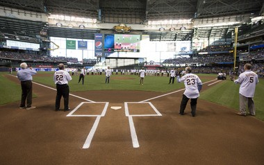 As part of the pregame ceremony for the Milwaukee Brewers Wall of Honor, Bud Selig, Robin Yount, Greg Vaughn and Craig Counsell throw ceremonial pitches to Bob Uecker, Charlie Moore, Ted Simmons and B.J. Surhoff. (Courtesy of the Milwaukee Brewers)
