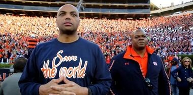 """Auburn basketball legend Charles Barkley, left, and baseball legend Frank Thomas watch the 2013 Iron Bowl from the sideline in the SEC Storied documentary """"Bo, Barkley and The Big Hurt."""" (Courtesy SEC Network/ESPN)"""