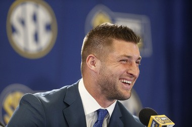 Former NFL player Tim Tebow speaks during a an SEC television broadcast, Friday, Dec. 5, 2014, in Atlanta, ahead of the Southeastern Conference championship football game between Alabama and Missouri held Saturday. (AP Photo/Brynn Anderson)