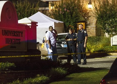 Auburn police cordon off the scene at the University Heights apartment complex on West Longleaf Drive early Sunday, June 10, 2012, in Auburn, Alabama. (AP Photo/Opelika-Auburn News, Vasha Hunt)