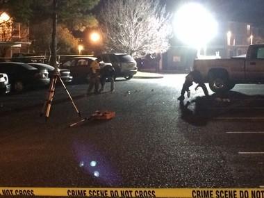 Police investigators explore the crime scene at the Tiger Lodge apartment complex, where Auburn football player Jakell Mitchell was shot to death in the early morning of Sunday, Dec. 14, 2014. (Brandon Marcello/bmarcello@al.com)