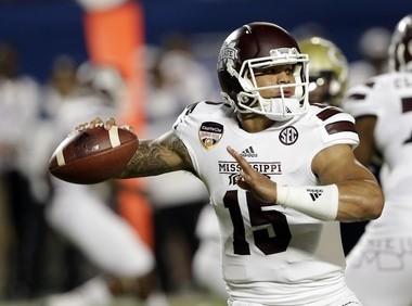 Mississippi State QB Dak Prescott is the preseason MVP choice in a voting of the SEC's 14 football information directors. (AP Photo/Wilfredo Lee)