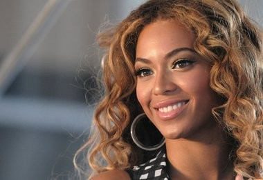 This photo taken June 22, 2009 shows singer Beyonce Knowles posing for pictures at a press conference in New York. In this year's Senior Bowl player survey, Beyonce was the top choice among the 43 players casting a vote to be lead cheerleader for their NFL team.(AP Photo/Peter Kramer)