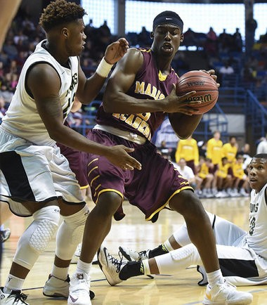 Madison Academy's Joshua Langford is guarded by Colbert County's Ron Beckwith during the AHSAA 3A Boys Northwest Regional basketball semifinal game, Saturday, Feb. 14, 2015, at the Tom Drake Coliseum in Hanceville, Ala. (Contributed by Jeff Johnsey)