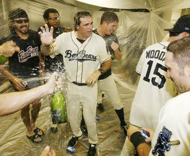 Mobile BayBears manager Turner Ward (center) gets sprayed with champagne in the locker room after the BayBears beat the Birmingham Barons to win the Southern League's South Division title on Sept. 12, 2011, at Hank Aaron Stadium in Mobile.