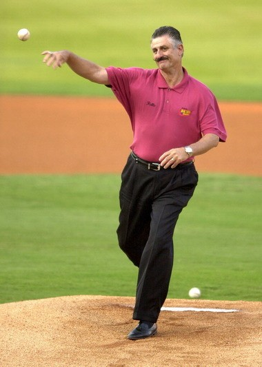 Rollie Fingers throws out the ceremonial first pitch before a Southern League game between the Birmingham Barons and the West Tenn Diamond Jaxx at Hoover Metropolitan Stadium on Aug. 7, 2004.