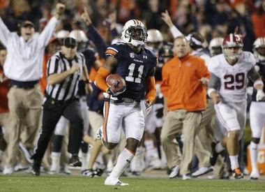 Auburn cornerback Chris Davis (11) returns a field goal attempt 109 yards to score the winning touchdown over Alabama in the Iron Bowl on Nov. 30, 2013. (AP Photo/Dave Martin, file)