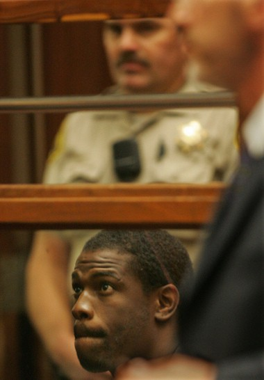 FILE - In this June 2, 2005, file photo, former NFL running back Lawrence Phillips is arraigned in Superior Court in the Foltz Criminal Courts Building in Los Angeles. Phillips has been charged with murder in the death of his cellmate at a Central California prison. (Anne Cusack/Los Angeles Times via AP, Pool File)