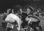Johnny Musso (left) is congratulated by Auburn quarterback Pat Sullivan following the Tigers' loss in the 1971 Iron Bowl. (AL.com file)