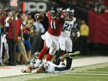 Atlanta Falcons wide receiver Julio Jones stays in bounds after catching a pass during an NFL game against the Philadelphia Eagles on Sept. 14, 2015, at the Georgia Dome in Atlanta.