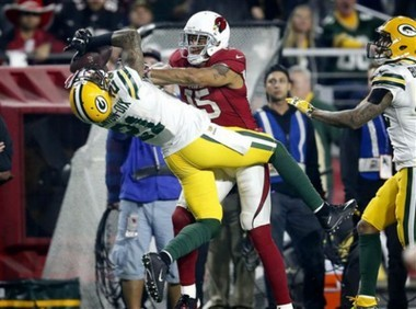 Green Bay Packers free safety Ha Ha Clinton-Dix intercepts a pass intended for Arizona Cardinals wide receiver Michael Floyd during an NFL playoff game on Jan. 16, 2016, in Glendale, Ariz.