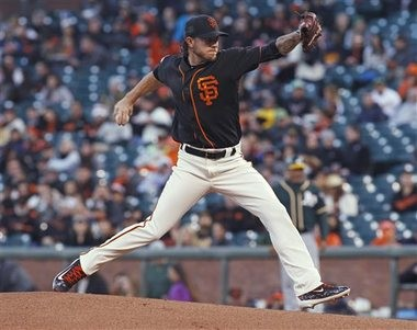 San Francisco Giants pitcher Jake Peavy throws to the Oakland Athletics during the first inning of an exhibition baseball game Friday, April 1, 2016, in San Francisco. (AP Photo/George Nikitin)