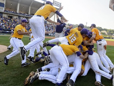 LSU piles up on the field and celebrates after winning the SEC Baseball Tournament championship game (Game 17), 2-0 over Florida, Sunday, May 25, 2014, at the Hoover Met in Hoover, Ala. Vasha Hunt/vhunt@al.com