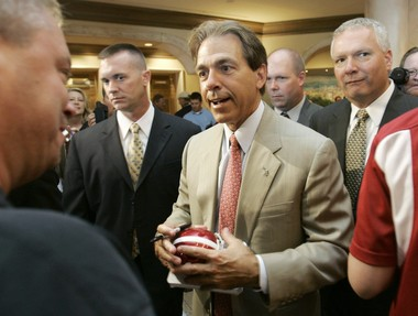 ARCHIVED PHOTO-Alabama coach Nick Saban signs autographs before leaving the Southeastern Conference football media days, Thursday, July 26, 2007, in Hoover, Ala.(AP Photo/Rob Carr)
