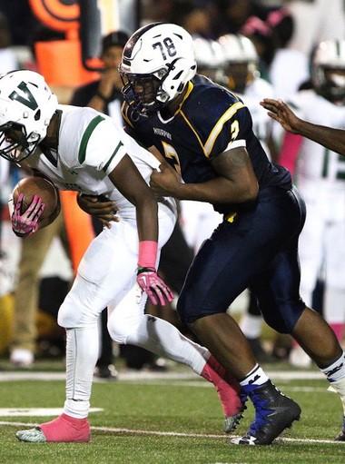 Murphy linebacker Kendric Haynes (3) stops Vigor quarterback Cameron Williams (2) in the second half of a prep football game on Thursday, Oct. 27, 2016, at Ladd-Peebles Stadium in Mobile, Ala. (Mike Kittrell/preps@al.com)