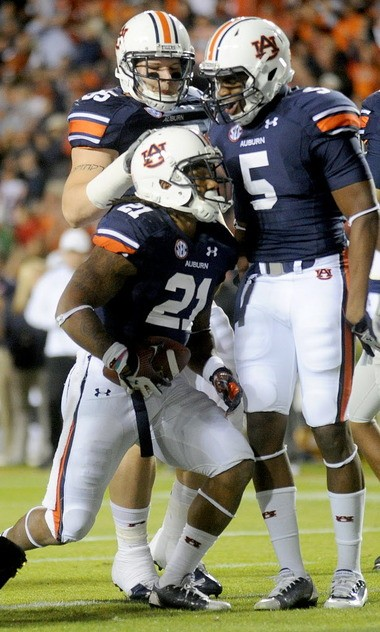 Auburn running back Tre Mason (21) celebrates with wide receiver Ricardo Louis (5) and fullback Jay Prosch after scoring a touchdown against Florida Atlantic of Oct. 26, 2013, at Jordan-Hare Stadium in Auburn, Ala.