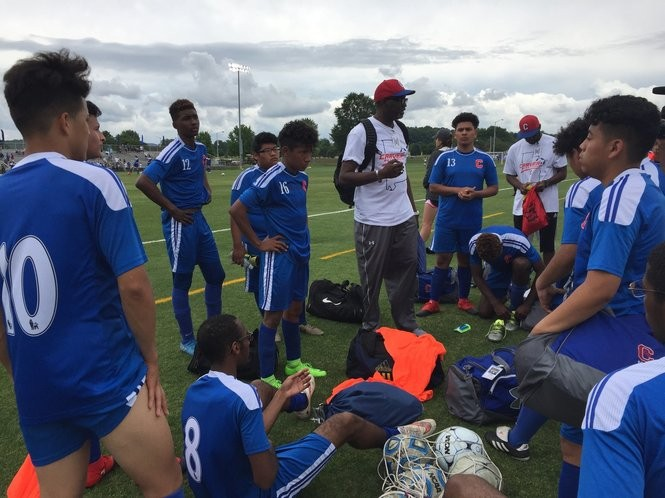 Carver boys' soccer coach Tenell Marshall address his team after the state semifinals. Marshall instructed his returning players to take two weeks off before beginning an offseason weight-training program.