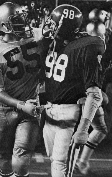 Alabama's Leroy Cook (98) shakes hands with Notre Dame's Sherm Smith (55) following the 1975 Orange Bowl game in Miami on Jan. 1, 1975. Notre Dame won the game 13-11. (Photo courtesy of Paul W. Bryant Museum)