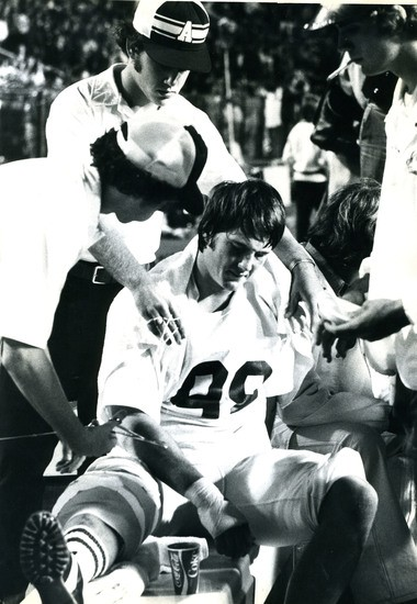 Alabama's Leroy Cook sits on the sideline after injuring his knee against Auburn on Nov. 29, 1975, at Legion Field in Birmingham. The injury cost Cook a shot at an NFL career. (Photo courtesy of Paul W. Bryant Museum)