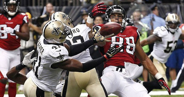 New Orleans Saints safety Roman Harper intercepts a pass during an NFL game against the Atlanta Falcons on Sept. 8, 2013, at the Mercedes-Benz Superdome in New Orleans.