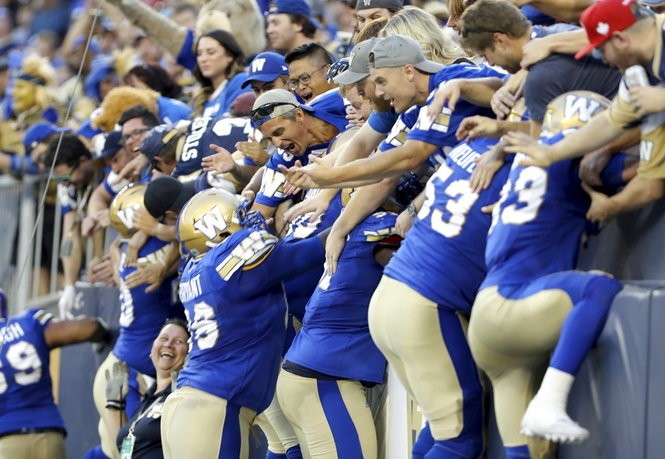 The Winnipeg Blue Bombers celebrate a touchdown against the Edmonton Eskimos during a Canadian Football League game on Thursday, Aug. 17, 2017, in Winnipeg, Manitoba.