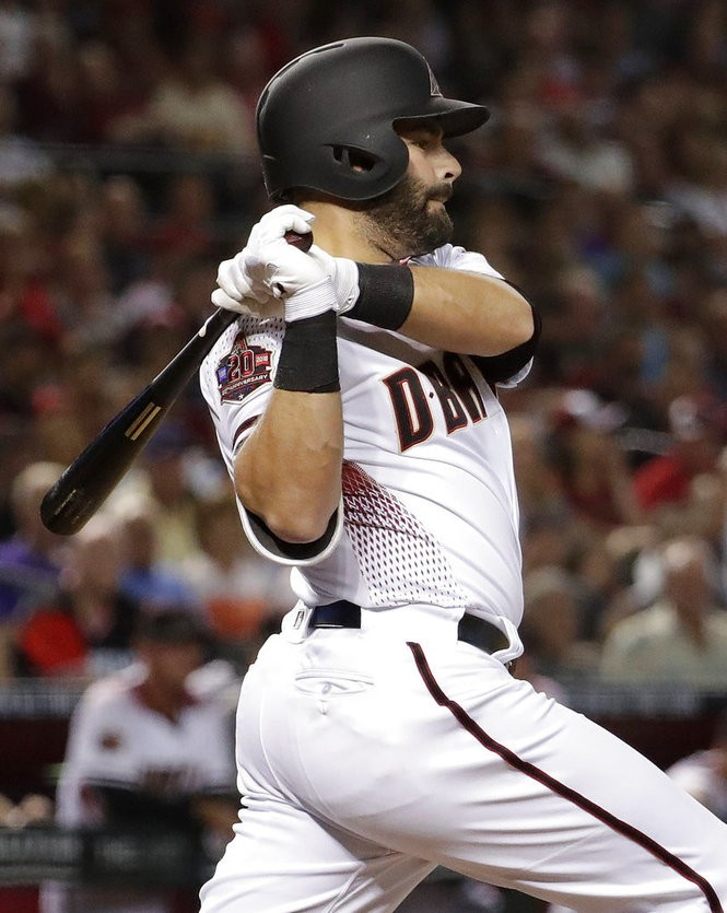 Arizona Diamondbacks catcher Alex Avila hits against the Colorado Rockies during a National League game on Thursday, March 29, 2018, in Phoenix.