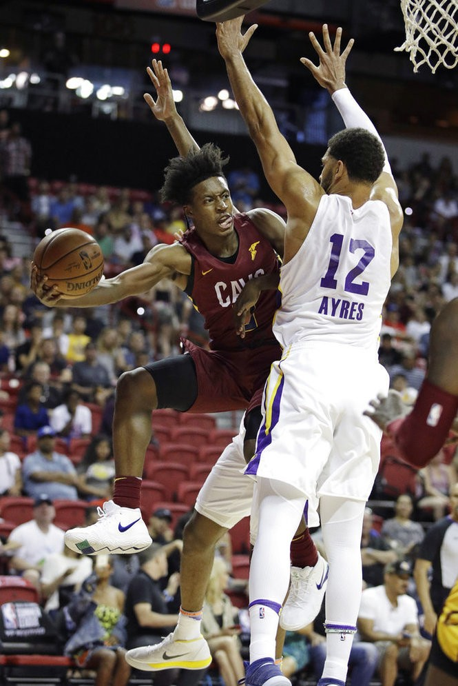 4fda70405e03 Cleveland Cavaliers guard Collin Sexton passes around the Los Angeles Lakers   Jeff Ayres during an