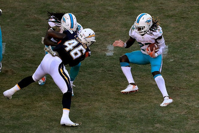 San Diego Chargers defensive end Chris Landrum (46) tries to get to Miami Dolphins running back Jay Ajayi during an NFL game on Nov. 13, 2016, in San Diego.