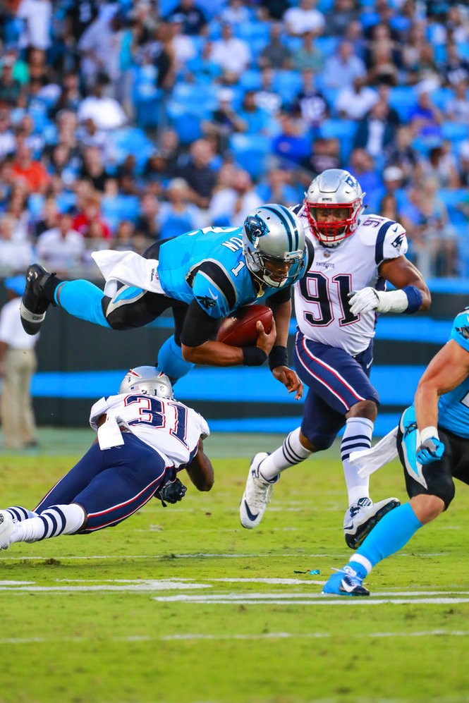 4d887996f57 Carolina Panthers quarterback Cam Newton is tackled by New England Patriots  cornerback Jonathan Jones during an