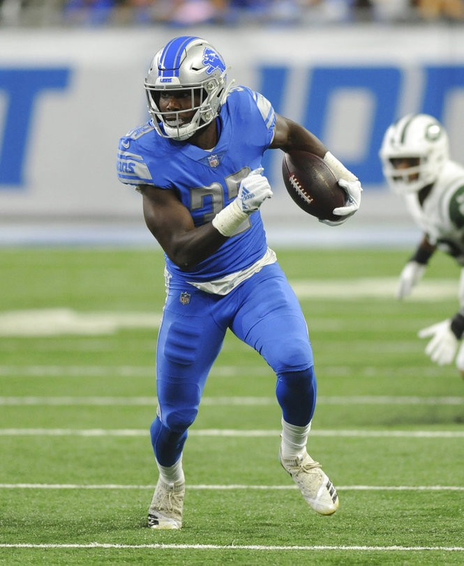 Detroit Lions running back Kerryon Johnson carries the football during an NFL game against the New York Jets on Monday, Sept. 10, 2018, in Detroit.